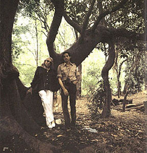 Photo of Ocampo and Sessa among trees.